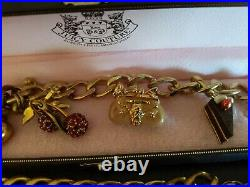 2 Juicy Couture Gold Tone Charm Bracelet. Rare charms purse, cake, cherries