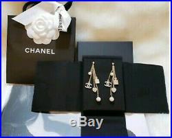 CHANEL Classic CC Gold Tone Pearl Charm Long Dangle Earrings