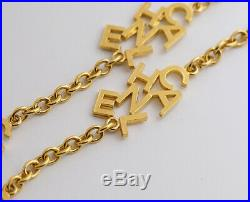 CHANEL Logo charm Necklace 35 inch long Gold Tone Vintage Authentic