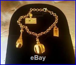 CHRISTIAN DIOR Goldtone bracelet parfums charm, new