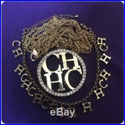 Carolina Herrera Round Rhinestone Logo Gold Tone Pendant With Charm Bracelet