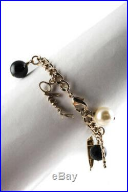 Chanel 2010 Cruise Gold Tone Black Enamel 100 year Anniversary Faux Pearl Charm