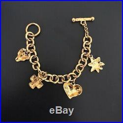 Christian Lacroix vintage charm bracelet heart star cross taurus gold tone 1990s