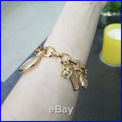 Henri Bendel Charm Bracelet gold tone enamel